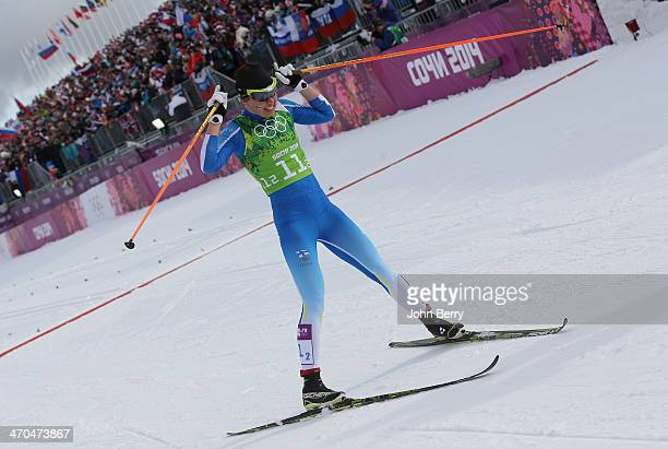 Silver medalist Kerttu Niskanen of Finland celebrates after crossing the line in the Women's Team Sprint Classic Final during day 12 of the 2014...