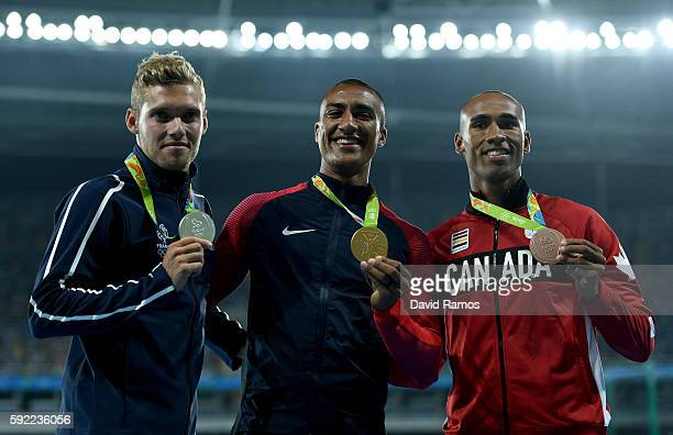 Silver medalist Kevin Mayer of France gold medalist Ashton Eaton of the United States and bronze medalist Damian Warner of Canada pose on the podium...