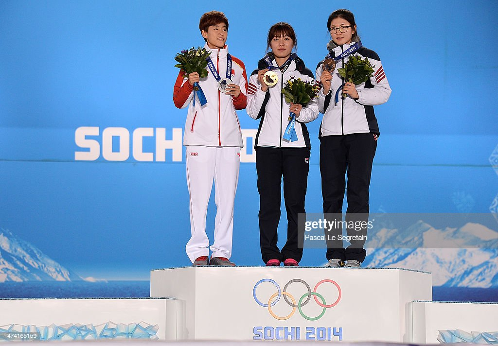 Silver medalist Kexin Fan of China, gold medalist Seung-Hi Park of South Korea and bronze medalist Suk Hee Shim of South Korea celebrate on the podium during the medal ceremony for the Short Track Women's 1000m on Day 15 of the Sochi 2014 Winter Olympics at Medals Plaza on February 22, 2014 in Sochi, Russia.