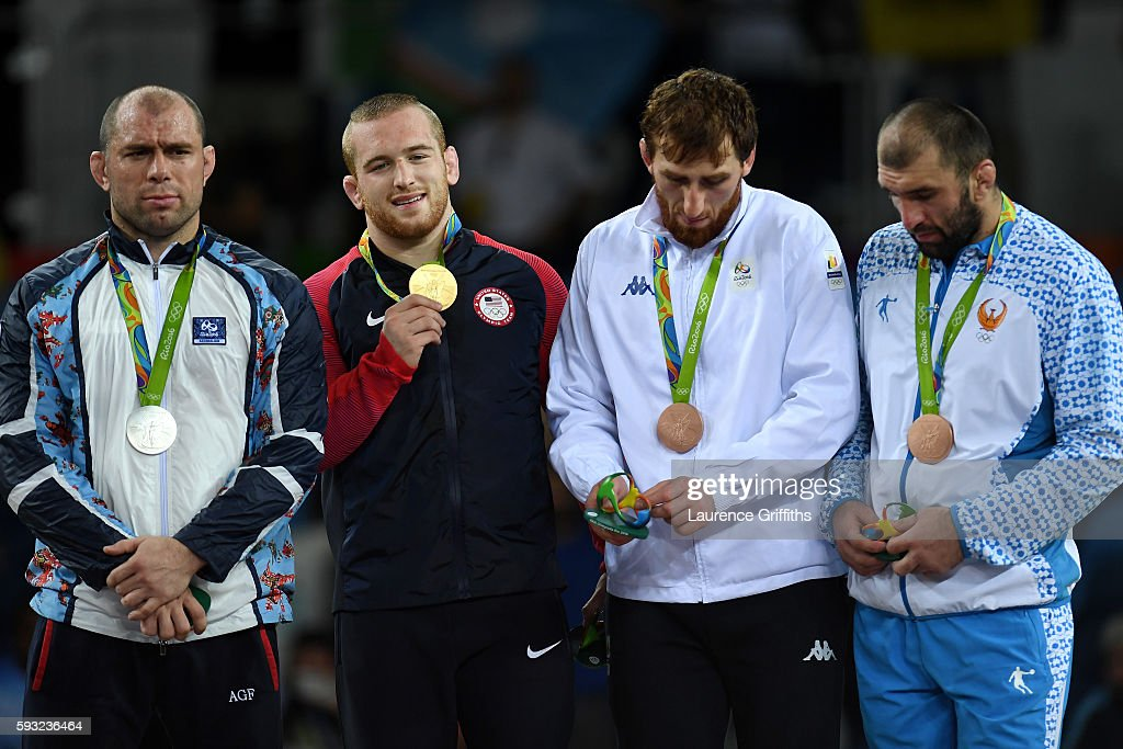 Silver medalist Khetag Goziumov of Azerbaijan, gold medalist Kyle Frederick Snyder of the United States, bronze medalist Albert Saritov of Romania and bronze medalist Magomed Idrisovitch Ibragimov of Uzbekistan stand on the podium during the medal ceremony for the Men's Freestyle 97kg on Day 16 of the Rio 2016 Olympic Games at Carioca Arena 2 on August 21, 2016 in Rio de Janeiro, Brazil.