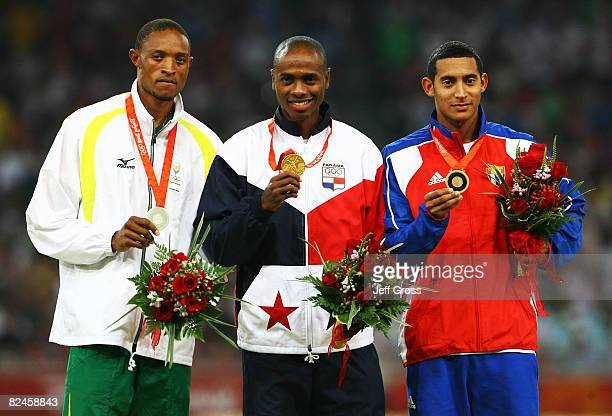 Silver medalist Khotso Mokoena of South Africa gold medalist Irving Jahir Saladino Aranda of Panama and bronze medalists Ibrahim Camejo of Cuba stand...