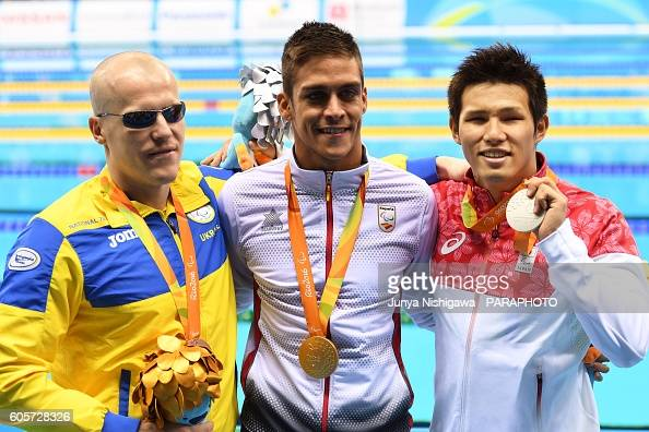 Silver medalist KIMURA Keiichi of JAPAN celebrates on the podium at the medal ceremony for the Men's 100m Butterfly S11 Final on day 7 of the Rio...