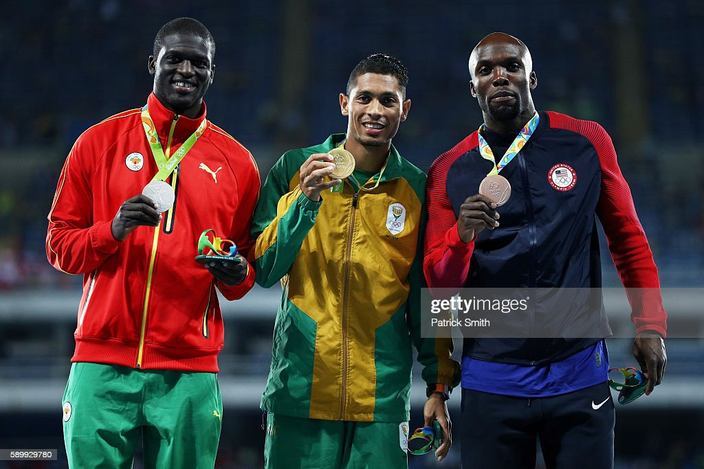 Silver medalist Kirani James of Grenada, gold medalist Wayde van Niekerk of South Africa and bronze medalist LaShawn Merritt of the United States pose on the podium during the medal ceremony for the Men's 400 metres on Day 10 of the Rio 2016 Olympic Games at the Olympic Stadium on August 15, 2016 in Rio de Janeiro, Brazil.