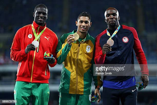 Silver medalist Kirani James of Grenada gold medalist Wayde van Niekerk of South Africa and bronze medalist LaShawn Merritt of the United States pose...