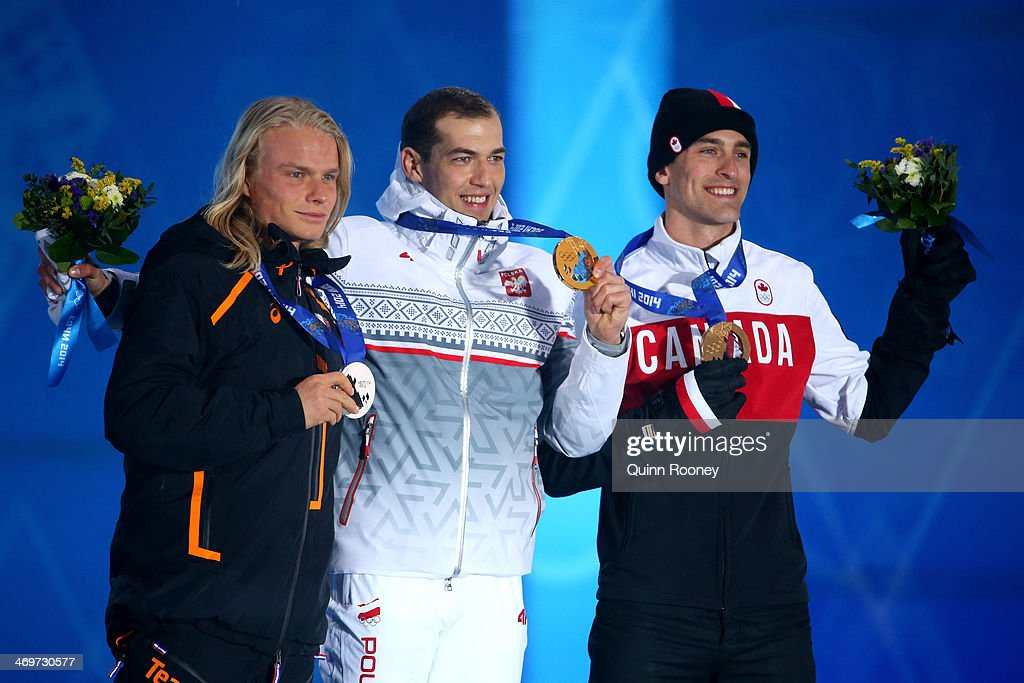 Silver medalist Koen Verweij of Netherlands, gold medalist Zbigniew Brodka of Poland and bronze medalist Denny Morrison of Canada celebrate on the podium during the medal ceremony for the Men's 1500 m Speed Skating on day 9 of the Sochi 2014 Winter Olympics at Medals Plaza on February 16, 2014 in Sochi, Russia.