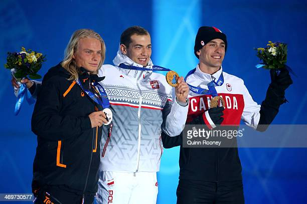 Silver medalist Koen Verweij of Netherlands gold medalist Zbigniew Brodka of Poland and bronze medalist Denny Morrison of Canada celebrate on the...