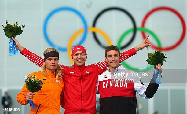 Silver medalist Koen Verweij of the Netherlands gold medalist Zbigniew Brodka of Poland and Bronze medalist Denny Morrison of Canada celebrates...