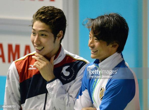 Silver medalist Kosuke Hagino and gold medalist Ryosuke Irie are seen waiting for the Men's 200m Backstroke award ceremony during day four of the...