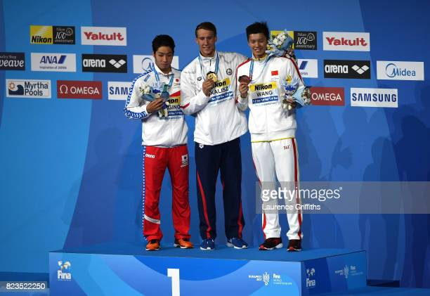 Silver medalist Kosuke Hagino of Japan and gold medalist Chase Kalisz of the United States and bronze medalist Shun Wang of China pose with the...