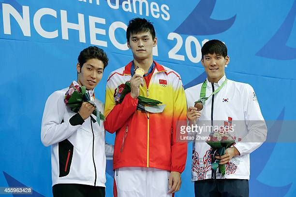 Silver medalist Kosuke Hagino of Japan Gold medalist Sun Yang of China and Bronze medalists Park Taehwan of South Korea celebrate during the medal...