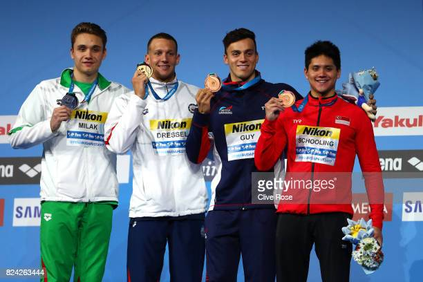 Silver medalist Kristof Milak of Hungary gold medalist Caeleb Remel Dressel of the United States and bronze medalists James Guy of Great Britain and...