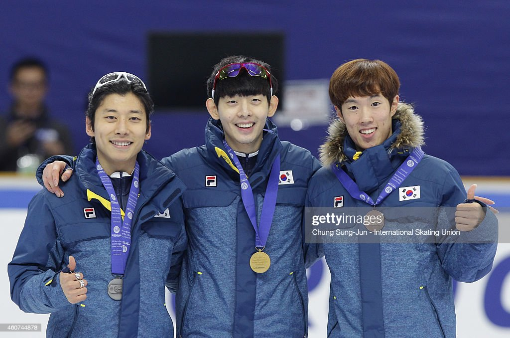 Silver medalist Kwak Yoon-Gy, Gold medalist <a gi-track='captionPersonalityLinkClicked' href=/galleries/search?phrase=Lee+Jung-Soo&family=editorial&specificpeople=5040502 ng-click='$event.stopPropagation()'>Lee Jung-Soo</a> and Bronze medalist Sin Da-Woon pose for medal ceremomy in the Men's 3000M Final A during the ISU World Cup Short Track Speed Skating 2014/15 - Seoul at Mokdong Ice Rink on December 21, 2014 in Seoul, South Korea.