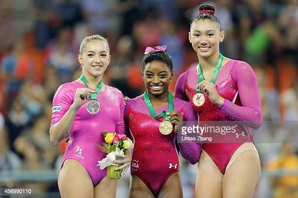 Silver medalist Larisa Andreea Iordache of Romania gold medalist Simone Biles of United States and Bronze medalist Kyla Ross of United States...