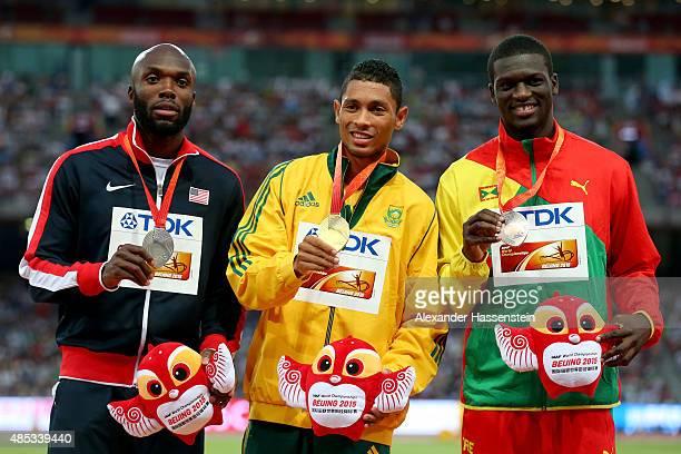 Silver medalist Lashawn Merritt of the United States gold medalist Wayde Van Niekerk of South Africa and bronze medalist Kirani James of Grenada pose...