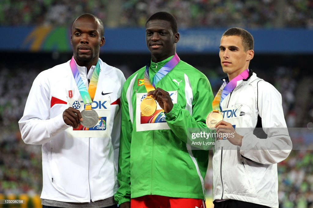 Silver medalist <a gi-track='captionPersonalityLinkClicked' href=/galleries/search?phrase=LaShawn+Merritt&family=editorial&specificpeople=546556 ng-click='$event.stopPropagation()'>LaShawn Merritt</a> of United States, gold medalist <a gi-track='captionPersonalityLinkClicked' href=/galleries/search?phrase=Kirani+James&family=editorial&specificpeople=5432961 ng-click='$event.stopPropagation()'>Kirani James</a> of Grenada and and bronze medalist <a gi-track='captionPersonalityLinkClicked' href=/galleries/search?phrase=Kevin+Borlee&family=editorial&specificpeople=2132831 ng-click='$event.stopPropagation()'>Kevin Borlee</a> of Belgium celebrate on the podium with their medals for the men's 400 metres during day six of 13th IAAF World Athletics Championships at Daegu Stadium on September 1, 2011 in Daegu, South Korea.