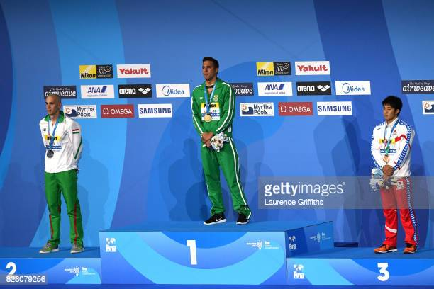 Silver medalist Laszlo Cseh of Hungary gold medalist Chad Le Clos of South Africa and bronze medalist Daiya Seto of Japan pose with the medals won...