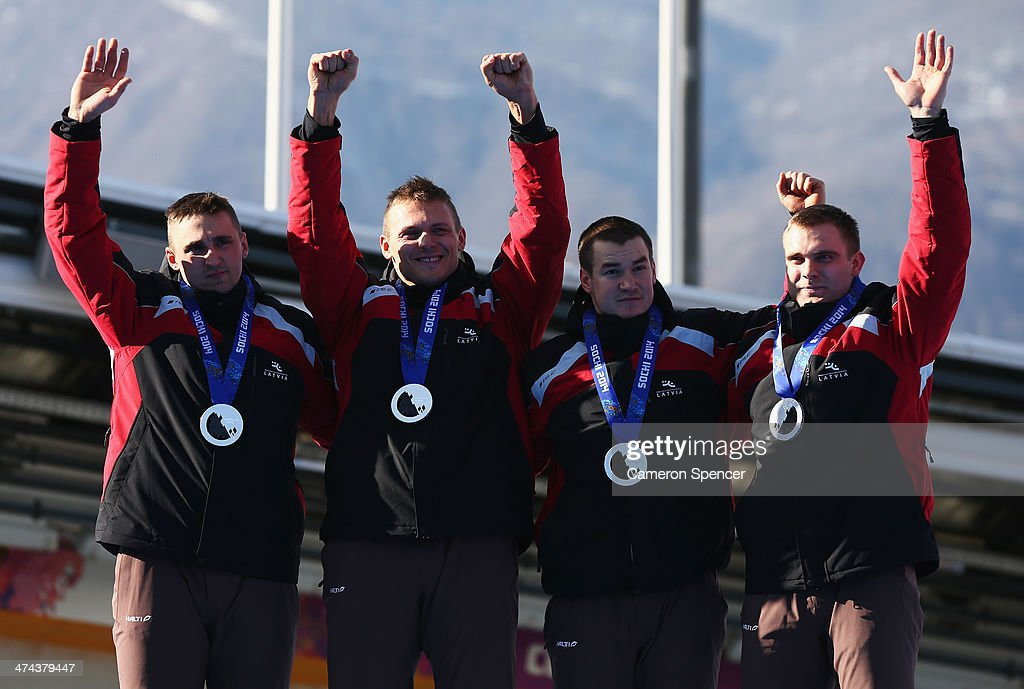 Silver medalist Latvia team 1 celebrates during the medal ceremony for the FourMan Bobsleigh on Day 16 of the Sochi 2014 Winter Olympics at Sliding...