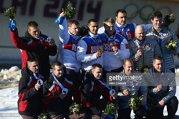 Silver medalist Latvia team 1 gold medalist Russia team 1 and bronze medalist the United States team 1 on the podium during the medal ceremony for...