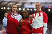 Silver medalist Laura Weightman of England gold medalist Faith Chepngetich Kibiegon of Kenya and bronze medalist Kate van Buskirk of Canada pose on...
