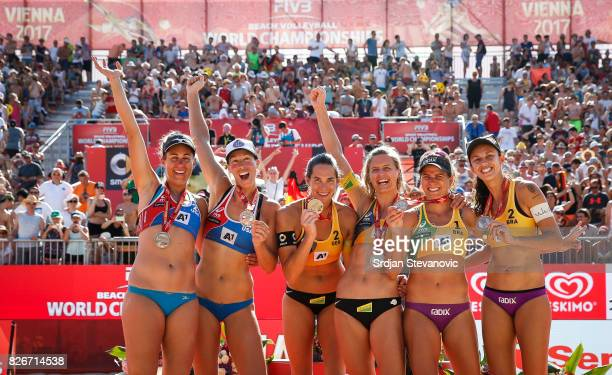 Silver medalist Lauren Fendrick and April Ross of USA Gold medalist Kira Walkenhorst and Laura Ludwig of Germany Bronze medalist Larissa Maestrini...