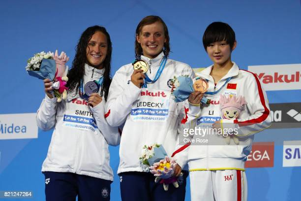 Silver medalist Leah Smith of the United States gold medalist Katie Ledecky of the United States and bronze medalist pose with the medals won during...