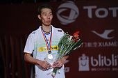Silver medalist Lee Chong Wei of Malaysia celebrates on the podium in the men singles final awarding ceremony of the 2015 Total BWF World...