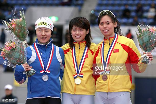 Silver medalist Lee Sanghwa of South Korea gold medalist Yu Jing of China and bronze medalist Xing Aihua of China pose for photographers on the...
