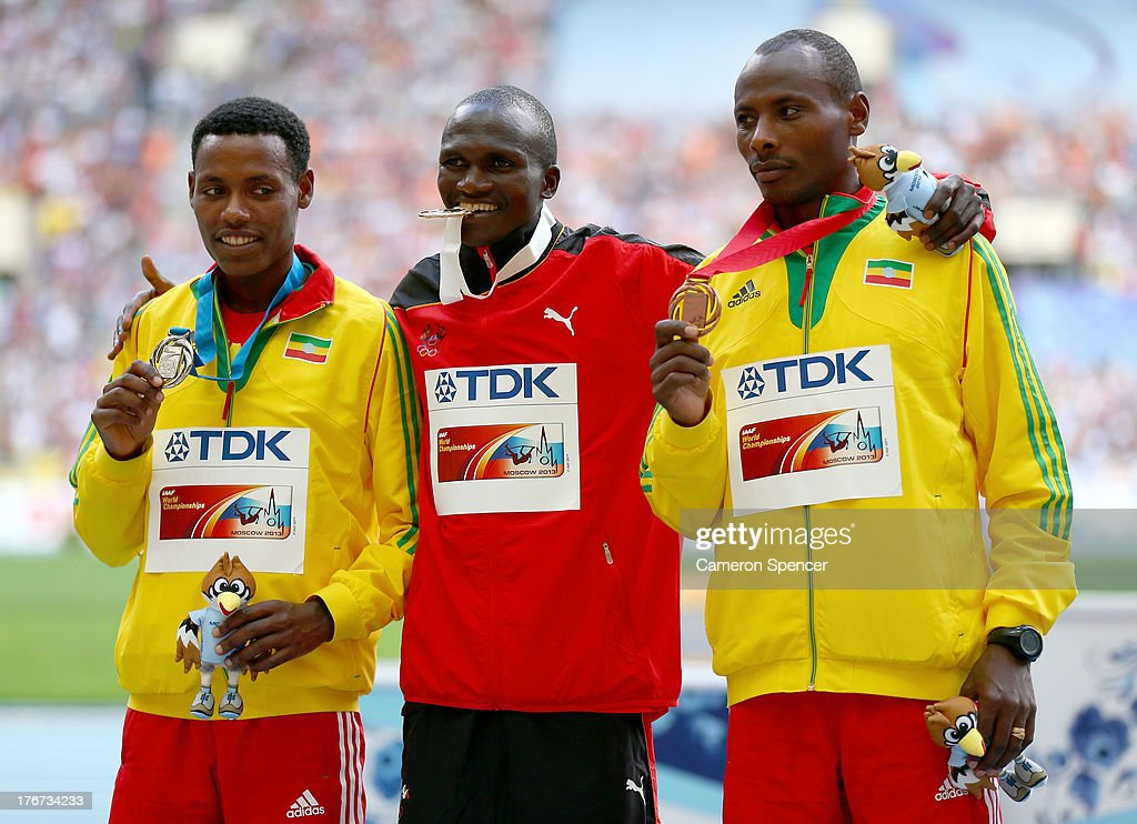 Silver medalist <a gi-track='captionPersonalityLinkClicked' href=/galleries/search?phrase=Lelisa+Desisa&family=editorial&specificpeople=7355535 ng-click='$event.stopPropagation()'>Lelisa Desisa</a> of Ethiopia, gold medalist <a gi-track='captionPersonalityLinkClicked' href=/galleries/search?phrase=Stephen+Kiprotich&family=editorial&specificpeople=7069481 ng-click='$event.stopPropagation()'>Stephen Kiprotich</a> of Uganda and bronze medalist <a gi-track='captionPersonalityLinkClicked' href=/galleries/search?phrase=Tadese+Tola&family=editorial&specificpeople=6896361 ng-click='$event.stopPropagation()'>Tadese Tola</a> of Ethiopia tand on the podium during the medal ceremony for the Men's Marathon during Day Nine of the 14th IAAF World Athletics Championships Moscow 2013 at Luzhniki Stadium on August 18, 2013 in Moscow, Russia.
