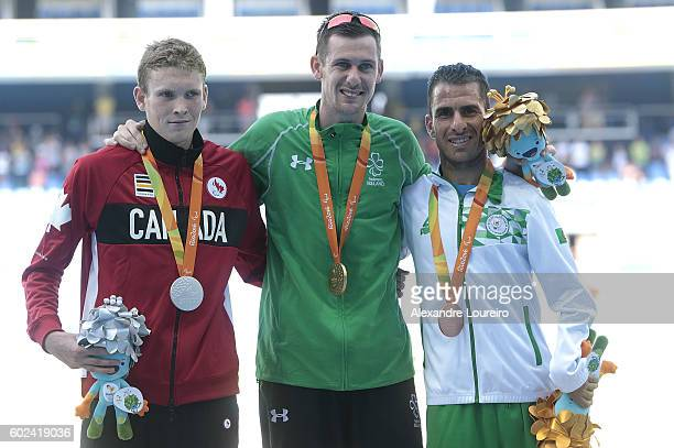 Silver Medalist Liam Stanley of Canada Gold medalist Michael McKillop of Irlend and Bronze medalist Madjid Djemai of Algeria celebrate on the podium...