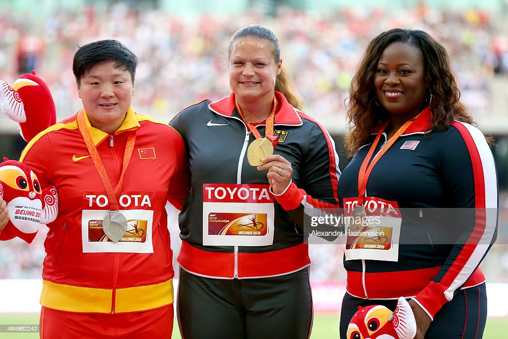 Silver medalist <a gi-track='captionPersonalityLinkClicked' href=/galleries/search?phrase=Lijiao+Gong&family=editorial&specificpeople=4472722 ng-click='$event.stopPropagation()'>Lijiao Gong</a> of China, gold medalist <a gi-track='captionPersonalityLinkClicked' href=/galleries/search?phrase=Christina+Schwanitz&family=editorial&specificpeople=2287569 ng-click='$event.stopPropagation()'>Christina Schwanitz</a> of Germany and bronze medalist <a gi-track='captionPersonalityLinkClicked' href=/galleries/search?phrase=Michelle+Carter&family=editorial&specificpeople=2984136 ng-click='$event.stopPropagation()'>Michelle Carter</a> of the United States pose on the podium during the medal ceremony for the Women's Shot Put during day two of the 15th IAAF World Athletics Championships Beijing 2015 at Beijing National Stadium on August 23, 2015 in Beijing, China.