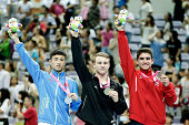 Silver medalist Liu Changxin of China Gold medalist Dylan Schmidt of New Zealand and Bronze medalist Pedro Ribeiro Ferreira of Portugal celebrate...