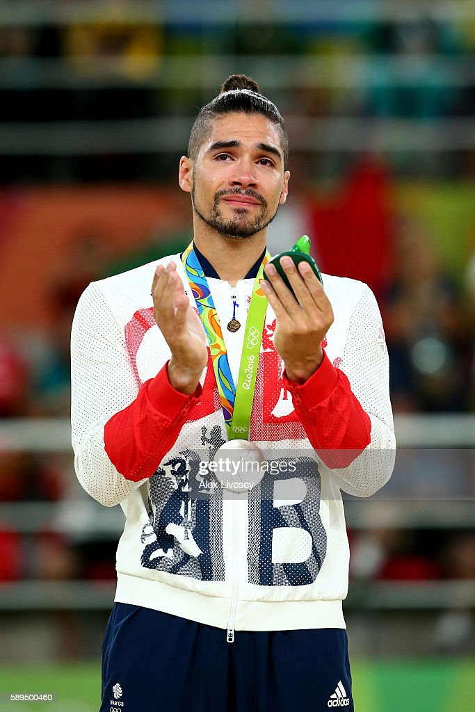 Silver medalist Louis Smith of Great Britain celebrates on the podium at the medal ceremony for the Men's Pommel Horse Final on Day 9 of the Rio 2016 Olympic Games at the Rio Olympic Arena on August 14, 2016 in Rio de Janeiro, Brazil.