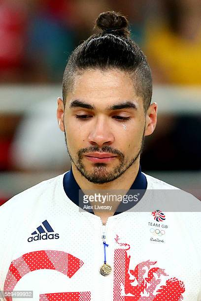 Silver medalist Louis Smith of Great Britain sheds tears with joy on the podium at the medal ceremony for the Men's Pommel Horse Final on Day 9 of...