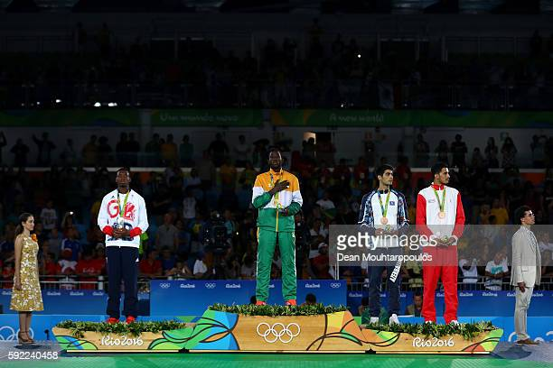 Silver medalist Lutalo Muhammad of Great Britain gold medalist Cheick Sallah Cisse of Cote d'Ivoire and bronze medalists Milad Beigi Harchegani of...