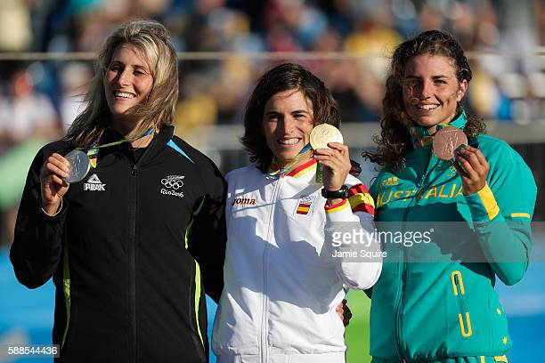 Silver medalist Luuka Jones of New Zealand gold medalist Maialen Chourraut of Spain and bronze medalist Jessica Fox of Australia pose on the podium...