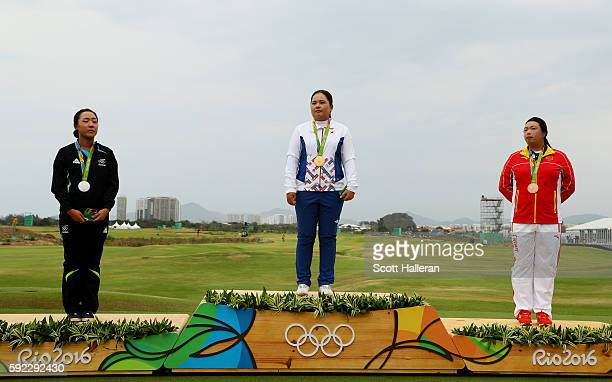 Silver medalist Lydia Ko of New Zealand gold medalist Inbee Park of Korea and bronze medalist Shanshan Feng of China pose on the podium during the...