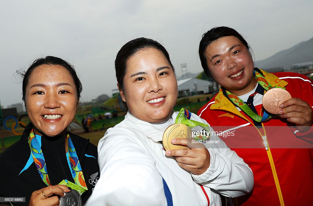 Silver medalist Lydia Ko of New Zealand gold medalist Inbee Park of Korea and bronze medalist Shanshan Feng of China pose after Women's Golf on Day...