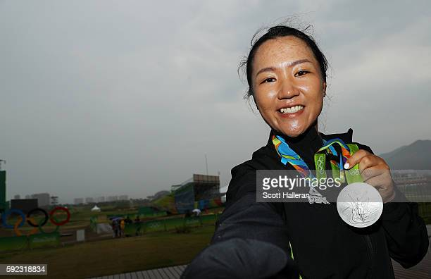 Silver medalist Lydia Ko of New Zealand poses for a photo after the Women's Golf on Day 15 of the Rio 2016 Olympic Games at the Olympic Golf Course...