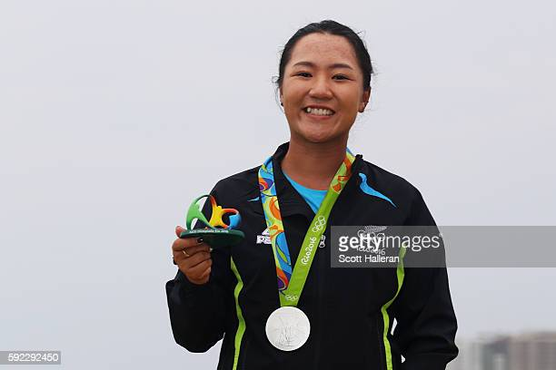 Silver medalist Lydia Ko of New Zealand poses on the podium during the medal ceremony for Women's Golf on Day 15 of the Rio 2016 Olympic Games at the...