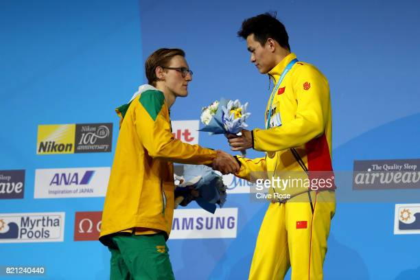Silver medalist Mack Horton of Australia and Gold medalist Yang Sun of China speak on the podium following the Men's 400m Freestyle Final on day ten...