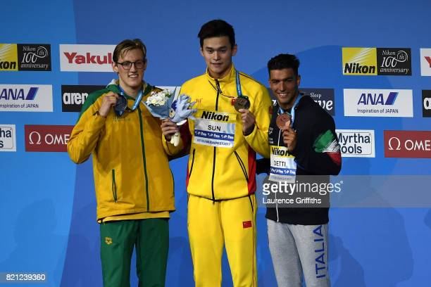 Silver medalist Mack Horton of Australia gold medalist Yang Sun of China and bronze medalist Gabriele Detti of Italy pose with the medals won during...
