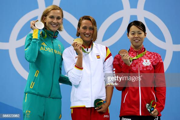 Silver medalist Madeline Groves of Australia Gold medalist Mireia Belmonte Garcia of Spain and bronze medalist Natsumi Hoshi of Japan pose on the...