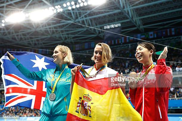 Silver medalist Madeline Groves of Australia Gold medalist Mireia Belmonte Garcia of Spain and bronze medalist Natsumi Hoshi of Japan pose during the...