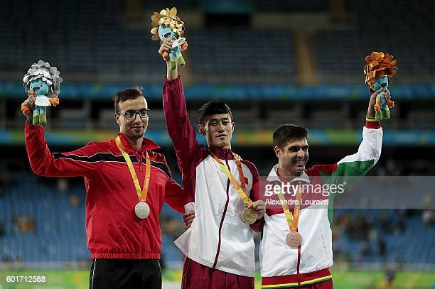 Silver medalist Mahdi Afri of Morocco gold medalist Qichao Sun of China and bronze medalist Luis Goncalves of Portugal celebrate on the podium at the...