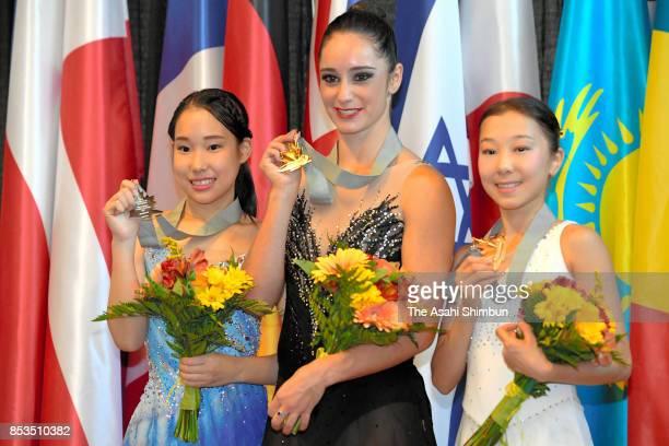 Silver medalist Mai Mihara of Japan gold medalist Kaetlyn Osmond of Canada and bronze medalist Elizabet Tursynbaeva of Kazakhstan pose on the podium...