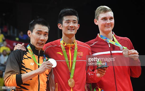 Silver medalist Malaysia's Lee Chong Wei Gold medalist China's Chen Long and Bronze medalist Denmark's Viktor Axelsen stand with their meals...
