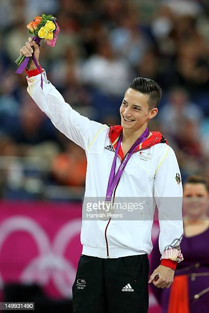 Silver medalist Marcel Nguyen of Germany poses on the podium during the medal ceremony for the Artistic Gymnastics Men's Parallel Bars on Day 11 of...