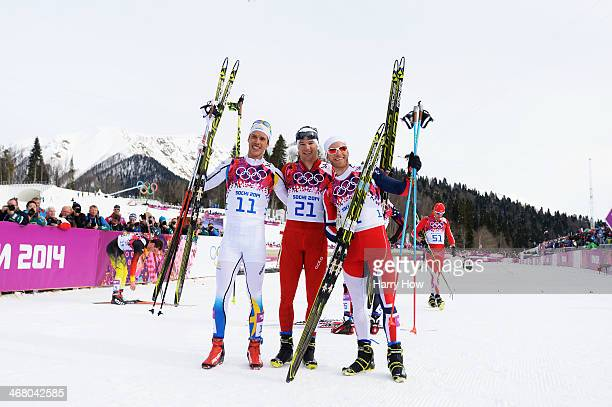 Silver medalist Marcus Hellner of Sweden gold medalist Dario Cologna of Switzerland and bronze medalist Martin Johnsrud Sundby of Norway celebrate...