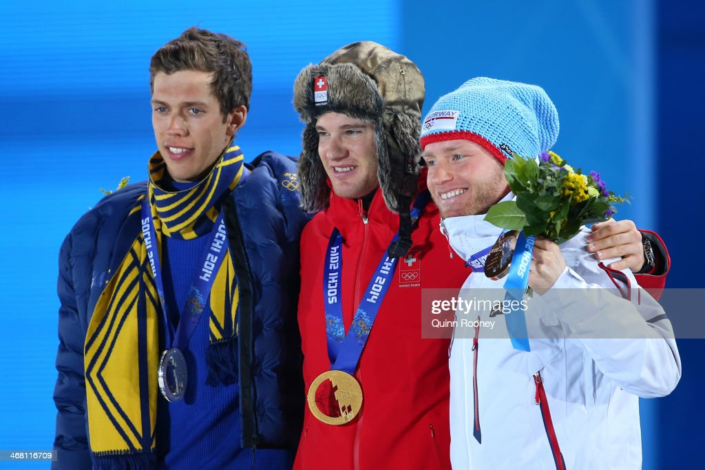 Silver medalist <a gi-track='captionPersonalityLinkClicked' href=/galleries/search?phrase=Marcus+Hellner&family=editorial&specificpeople=4046940 ng-click='$event.stopPropagation()'>Marcus Hellner</a> of Sweden, gold medalist <a gi-track='captionPersonalityLinkClicked' href=/galleries/search?phrase=Dario+Cologna&family=editorial&specificpeople=4779620 ng-click='$event.stopPropagation()'>Dario Cologna</a> of Switzerland and bronze medalist <a gi-track='captionPersonalityLinkClicked' href=/galleries/search?phrase=Martin+Johnsrud+Sundby&family=editorial&specificpeople=4668146 ng-click='$event.stopPropagation()'>Martin Johnsrud Sundby</a> of Norway pose on the podium during the medal ceremony for the Men's Skiathlon 15 km Classic + 15 km Free on day 2 of the Sochi 2014 Winter Olympics at Medals Plaza on February 9, 2014 in Sochi, Russia.