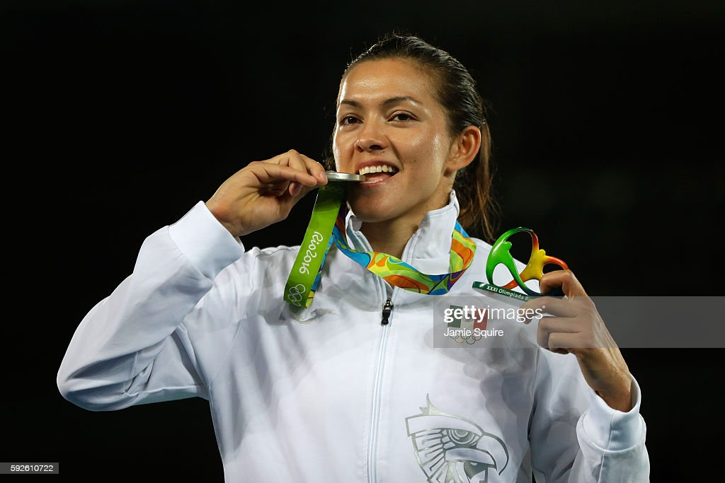 Silver medalist Maria del Rosario Espinoza Espinoza of Mexico celebrates on the podium during the medal ceremony for the Taekwondo Women 67kg Gold...
